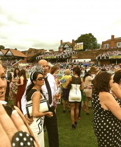 Punters, waiting for the horses on the last turn..
